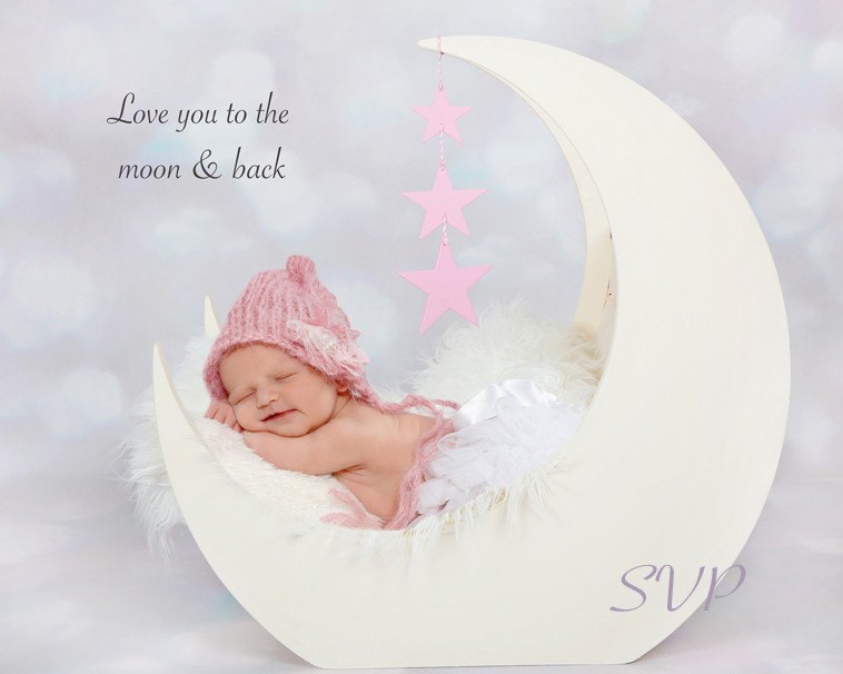 Newborn baby girl at 7 days young in our Moon Crib