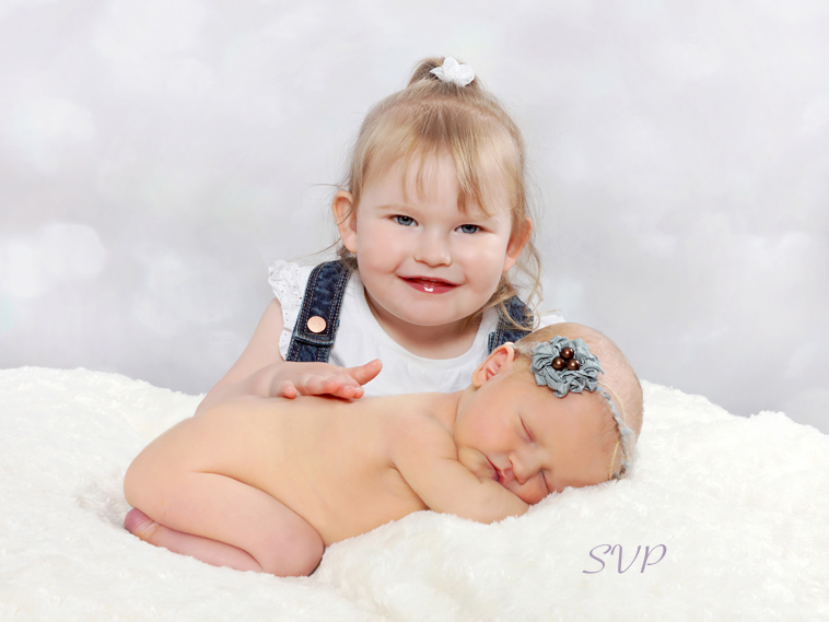 Newborn baby girl and her big sister